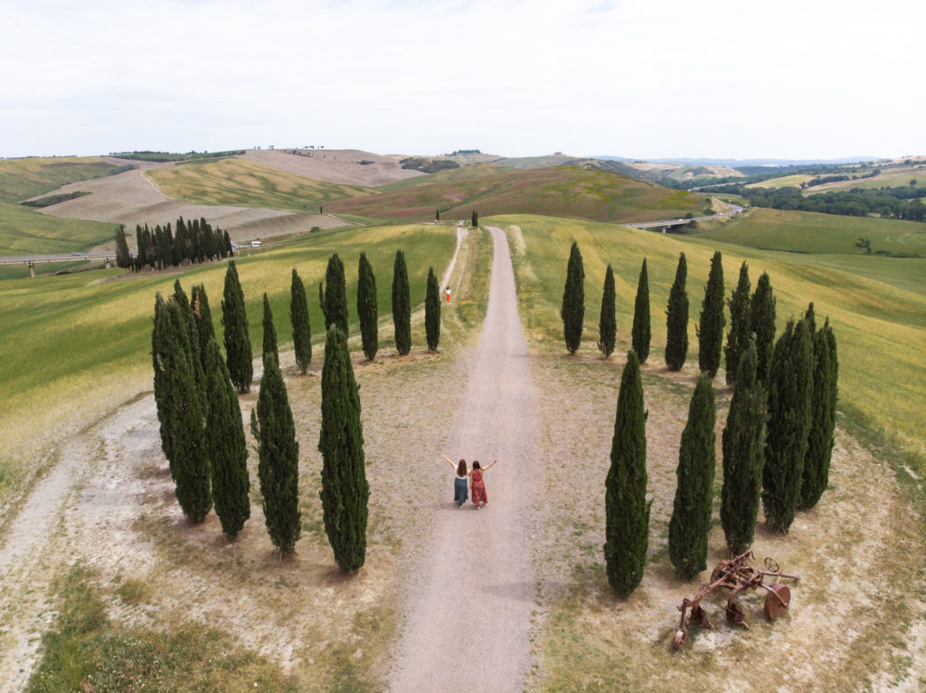 tuscany travel guide: drone shot of a cypress circle in val d'Orcia