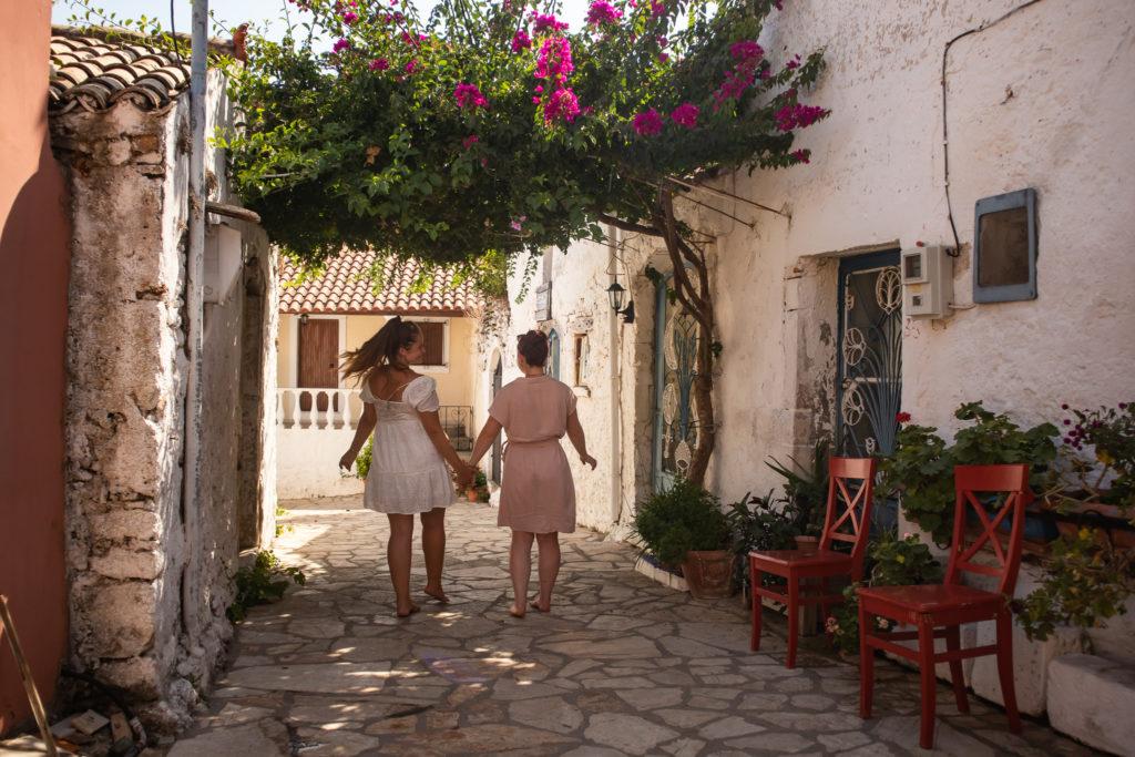 Corfu Greece Travel Guide: Afionas best friends walking through the beautiful alleys
