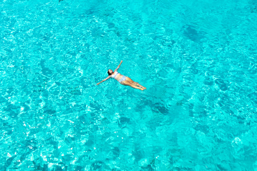 Corfu Greece Travel Guide: floating in the water of Antipaxos